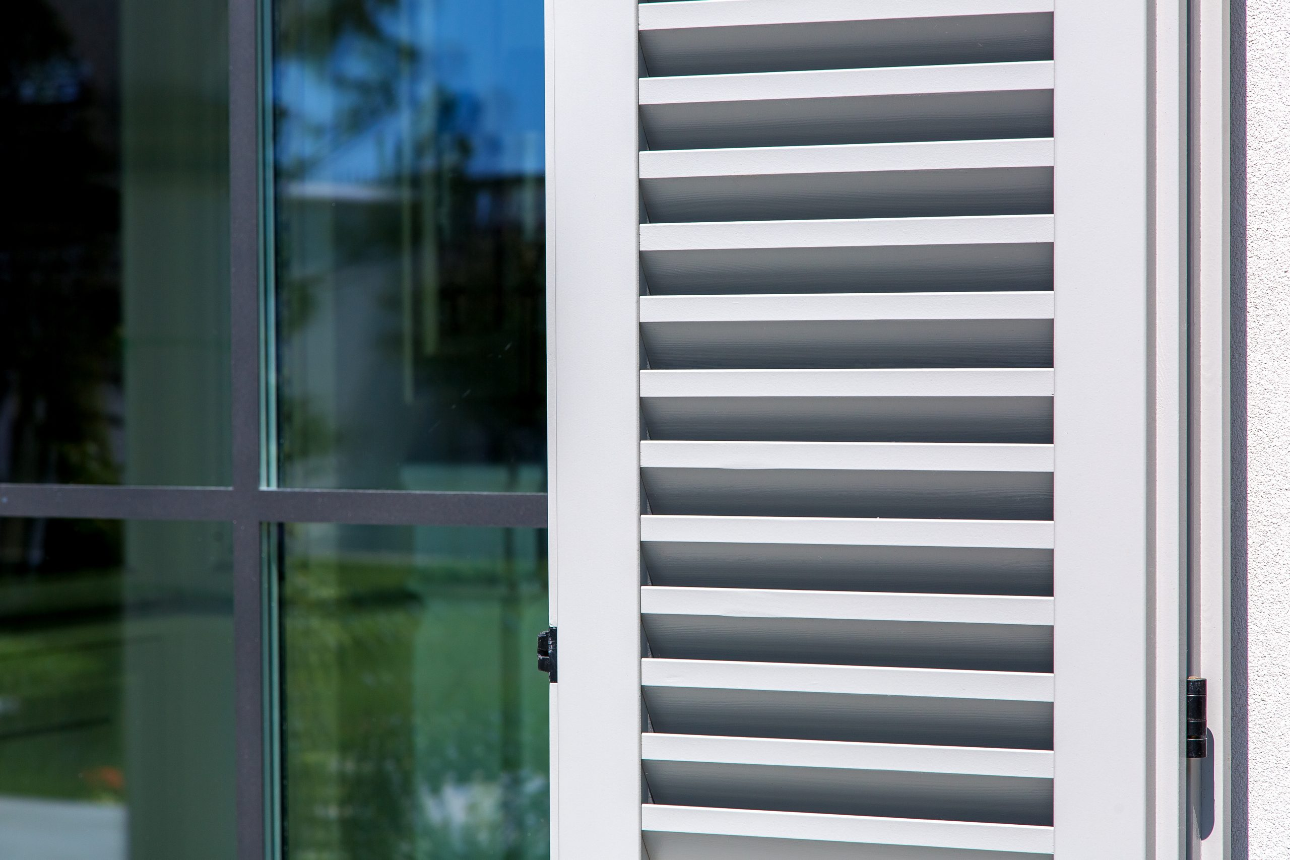 wooden shutters of gray color, close up of the exterior of the house in the Italian style.